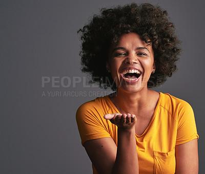 Buy stock photo Studio shot of a beautiful young woman blowing kisses