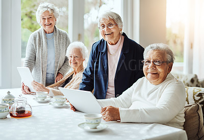 Buy stock photo Portrait of a group of senior women using a digital tablet together at a retirement home