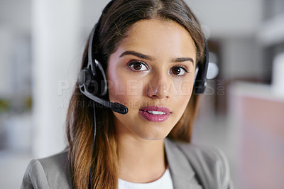 Buy stock photo Cropped portrait of a young female call center agent working in an office