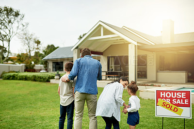 Buy stock photo Shot of a family of four viewing their new home together
