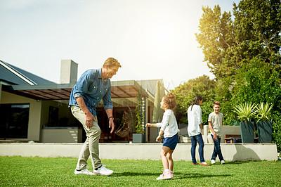 Buy stock photo Shot of a family having fun in their backyard