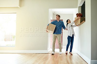 Buy stock photo Shot of a middle-aged couple moving into their new house