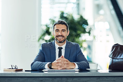 Buy stock photo Portrait of a mature businessman sitting in an airport cafe