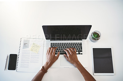 Buy stock photo Cropped high angle shot of a businesswoman using a laptop at her desk in a modern office