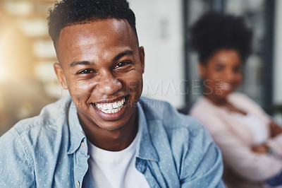 Buy stock photo Shot of a happy young man relaxing with his wife on the sofa at home