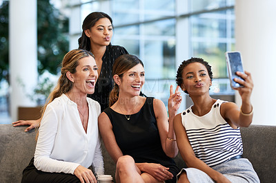Buy stock photo Cropped shot of a group of businesswomen taking a selfie together at the convention centre