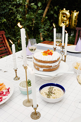 Buy stock photo Cropped shot of a birthday celebration setting outdoors