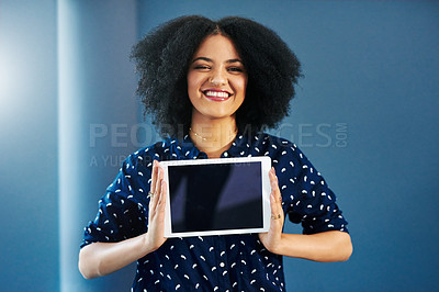 Buy stock photo Portrait of a happy young woman holding up a digital tablet with a blank screen