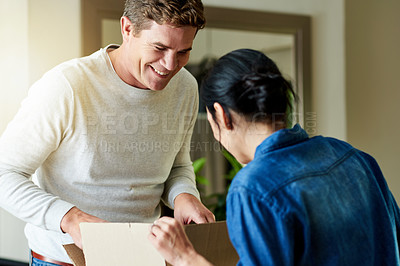 Buy stock photo Cropped shot of a couple moving into their new home