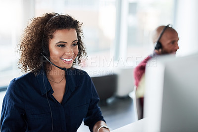 Buy stock photo Cropped shot of an attractive young female call center agent working in her office