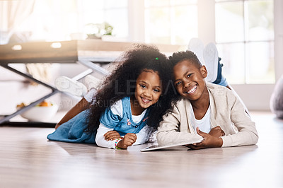 Buy stock photo Portrait of two adorable little siblings using a digital tablet together at home