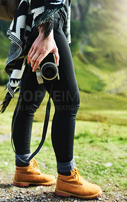 Buy stock photo Cropped shot of an unrecognizable woman out in nature with her camera