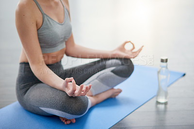 Buy stock photo Closeup shot of an unrecognizable woman meditating in a studio