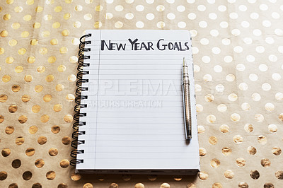"""Buy stock photo Shot of a notebook with the words """"New year goals"""" written on it"""