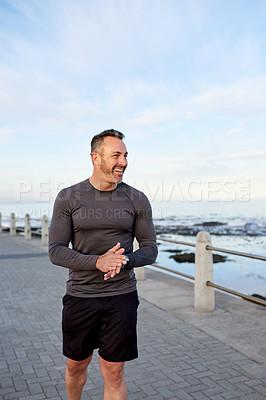 Buy stock photo Shot of a mature man exercising outdoors