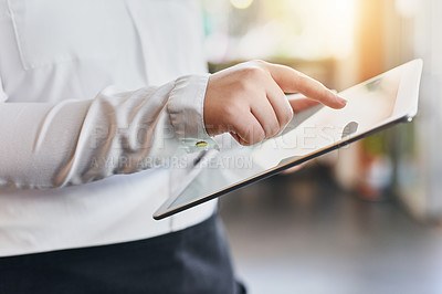 Buy stock photo Cropped shot of an unrecognizable woman using a digital tablet