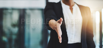 Buy stock photo Cropped shot of an unidentifiable businesswoman extending her arm for a handshake