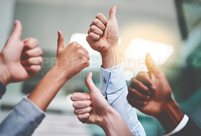Buy stock photo Cropped shot of a group of unrecognizable businesspeople showing thumbs up in an office