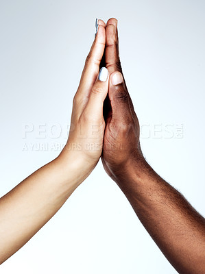 Buy stock photo Studio shot of two unrecognizable people holding their hands together against a grey background