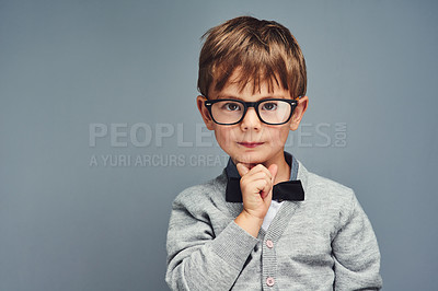 Buy stock photo Studio portrait of a smartly dressed little boy posing confidently against a gray background