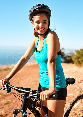 Buy stock photo Cropped portrait of an attractive young female cyclist out for a ride on her mountain bike
