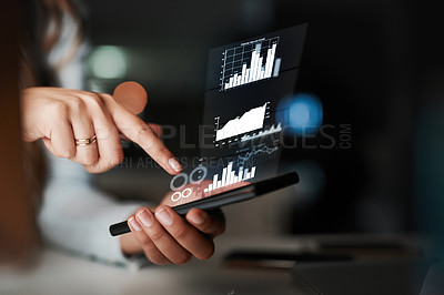 Buy stock photo High angle shot of an unrecognizable young businesswoman using her cellphone while working late in the office