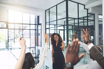 Buy stock photo Closeup shot of a group of businesspeople raising their hands during a presentation in an office