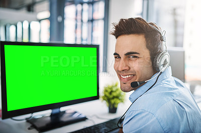 Buy stock photo Cropped portrait of a handsome young man using a computer with chromakey in a call center