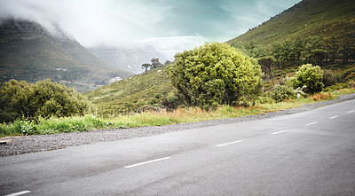 Buy stock photo Shot of a road on the mountainside