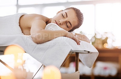 Buy stock photo shot of a young woman feeling relaxed while lying on a spa bed
