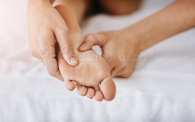 Buy stock photo Cropped shot of a woman getting a foot massage at a beauty spa