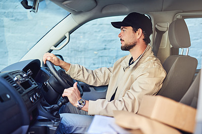 Buy stock photo Shot of a courier driving a delivery van