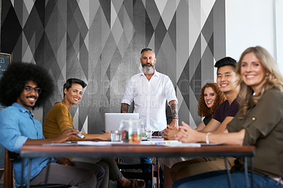 Buy stock photo Cropped portrait of a group creative colleagues sitting in the boardroom during a meeting