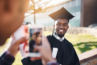 Buy stock photo Shot of a male student having his picture taken