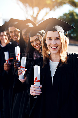 Buy stock photo Portrait of a group of students standing in a line on graduation day