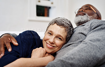 Buy stock photo Shot of an affectionate senior couple relaxing on the sofa at home