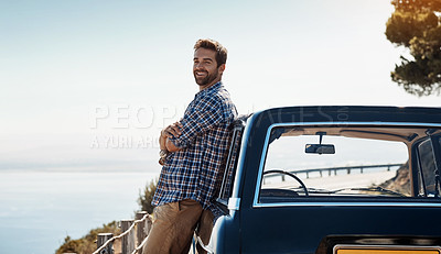 Buy stock photo Shot of a handsome young man out on road trip