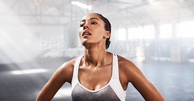 Buy stock photo Shot of young women catching her breath while working out in the gym