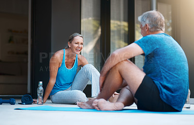 Buy stock photo Full length shot of a mature and happy couple taking a break after an intense workout session