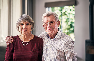 Buy stock photo Cropped portrait of an affectionate senior couple in their retirement home