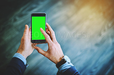 Buy stock photo Shot of an unrecognizable businessman using his cellphone at work