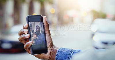 Buy stock photo Shot of a young couple taking a selfie together with a cellphone in the city