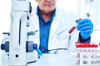 Buy stock photo Closeup shot of a scientist analyzing samples in a laboratory