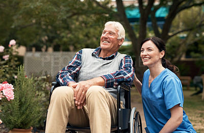 Buy stock photo Shot of a senior man in a wheelchair out for fresh air in the garden with his caregiver