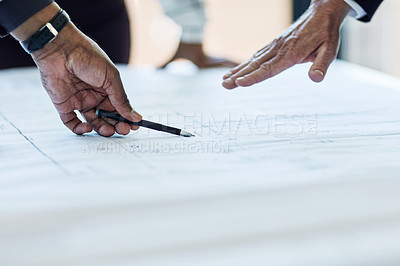 Buy stock photo Closeup shot of a group of businesspeople looking at blueprints in an office