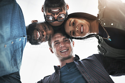 Buy stock photo Low angle portrait of a group of young business people posing together in a modern office