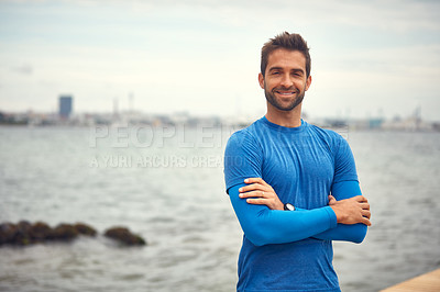 Buy stock photo Portrait of a sporty middle-aged man standing with his arms crossed