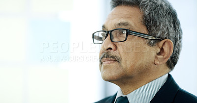 Buy stock photo Cropped shot of a handsome mature businessman working on a glass wipe board in his office