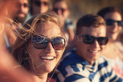 Buy stock photo Cropped portrait of a young woman taking a selfie with her friends at the beach
