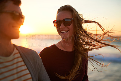 Buy stock photo Cropped shot of a young woman laughing with her boyfriend at the beach